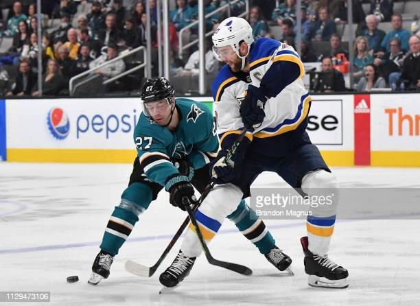 Joonas Donskoi of the San Jose Sharks fights for the puck against Alex Pietrangelo of the St Louis Blues at SAP Center on March 9 2019 in San Jose...
