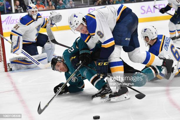 Joonas Donskoi of the San Jose Sharks fights for the puck with Sammy Blais against the St Louis Blues at SAP Center on November 17 2018 in San Jose...