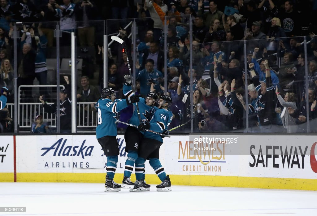 Joonas Donskoi #27 of the San Jose Sharks is congratulated by Timo Meier #28 and Dylan DeMelo #74 after he scored a goal against the Colorado Avalanche at SAP Center on April 5, 2018 in San Jose, California.