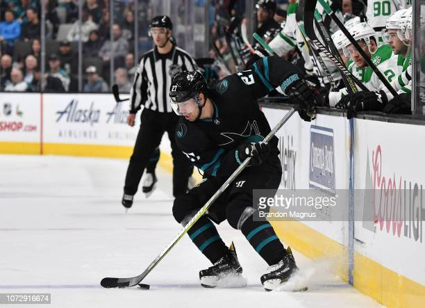 Joonas Donskoi of the San Jose Sharks moves the puck into the zone against the Dallas Stars at SAP Center on December 13 2018 in San Jose California