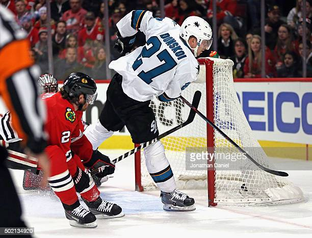 Joonas Donskoi of the San Jose Sharks scores a first period goal in front of Duncan Keith of the Chicago Blackhawks at the United Center on December...