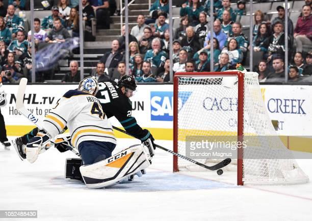 Joonas Donskoi of the San Jose Sharks scores a goal on Carter Hutton of the Buffalo Sabres at SAP Center on October 18 2018 in San Jose California