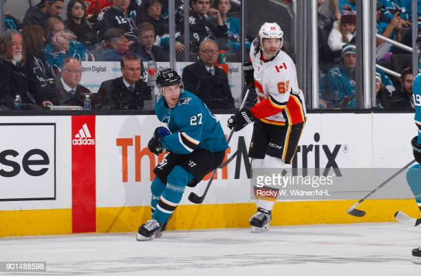 Joonas Donskoi of the San Jose Sharks skates against Jaromir Jagr of the Calgary Flames at SAP Center on December 28 2017 in San Jose California