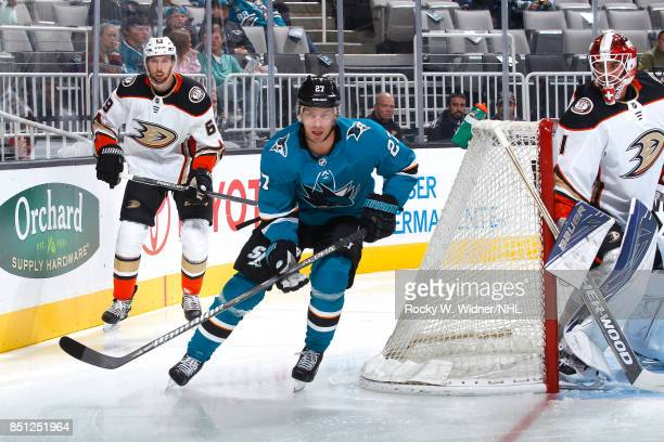 Joonas Donskoi of the San Jose Sharks skates against Marcus Pettersson of the Anaheim Ducks at SAP Center on September 19 2017 in San Jose California