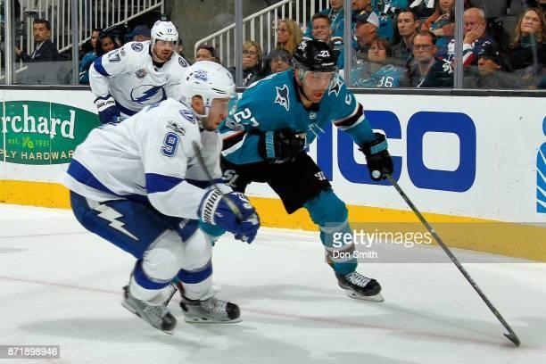 Joonas Donskoi of the San Jose Sharks skates against Tyler Johnson of the Tampa Bay Lightning at SAP Center on November 8 2017 in San Jose California