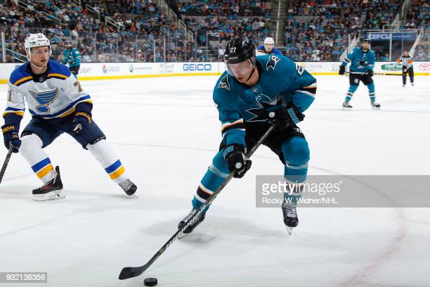 Joonas Donskoi of the San Jose Sharks skates with the puck against Vladimir Sobotka of the St Louis Blues at SAP Center on March 8 2018 in San Jose...