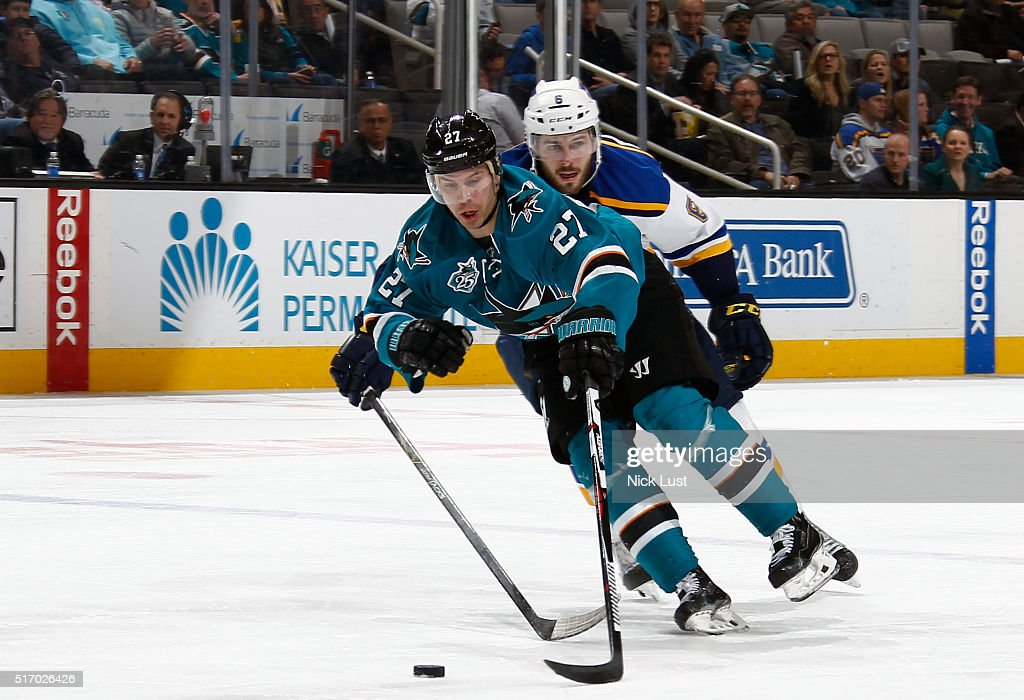 Joonas Donskoi #27 of the San Jose Sharks steals the puck against Joel Edmundson #6 of the St. Louis Blues during a NHL game at the SAP Center at San Jose on March 22, 2016 in San Jose, California.