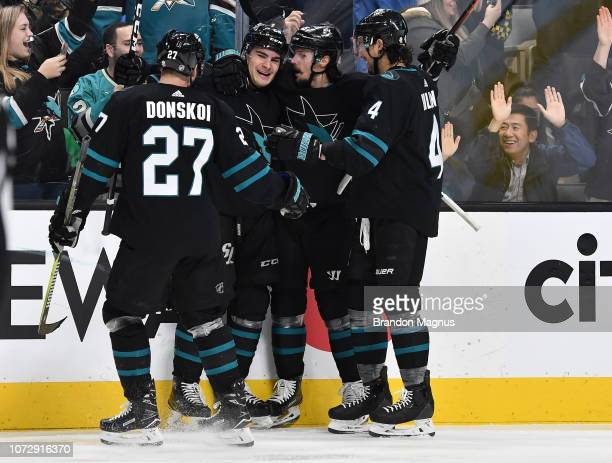 Joonas Donskoi Timo Meier Erik Karlsson and Brenden Dillon of the San Jose Sharks celebrate a goal against the Dallas Stars at SAP Center on December...