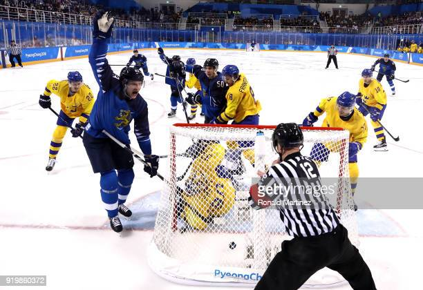 Joonas Kemppainen of Finland celebrates as he scores a goal in the second period against Viktor Fasth of Sweden during the Men's Ice Hockey...