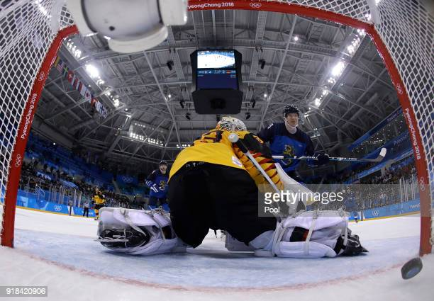 Joonas Kemppainen of Finland scores a goal against goalie Den Birken Danny Aus of Germany during the third period of the preliminary round of the...