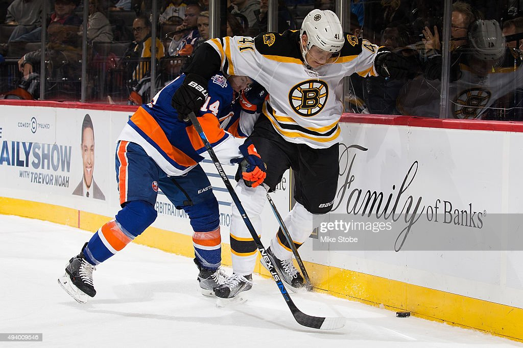 Joonas Kemppainen #41 of the Boston Bruins and Thomas Hickey #14 of the New York Islanders battle for the puck at the Barclays Center on October 23, 2015 in Brooklyn borough of New York City. The Bruins defeated the Islanders 5-3.
