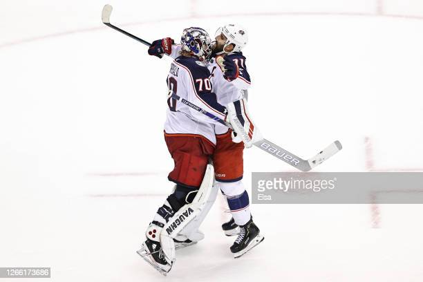 Joonas Korpisalo and Nick Foligno of the Columbus Blue Jackets celebrate their teams 3-1 win against the Tampa Bay Lightning in Game Two of the...