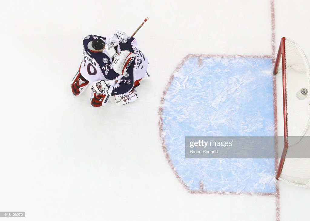Joonas Korpisalo #70 and Sergei Bobrovsky #72 of the Columbus Blue Jackets celebrate a 3-0 victory over the New Jersey Devils at the Prudential Center on March 5, 2017 in Newark, New Jersey.