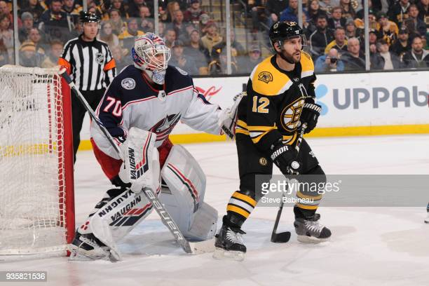 Joonas Korpisalo of the Columbus Blue Jackets against Brian Gionta of the Boston Bruins at the TD Garden on March 19 2018 in Boston Massachusetts...