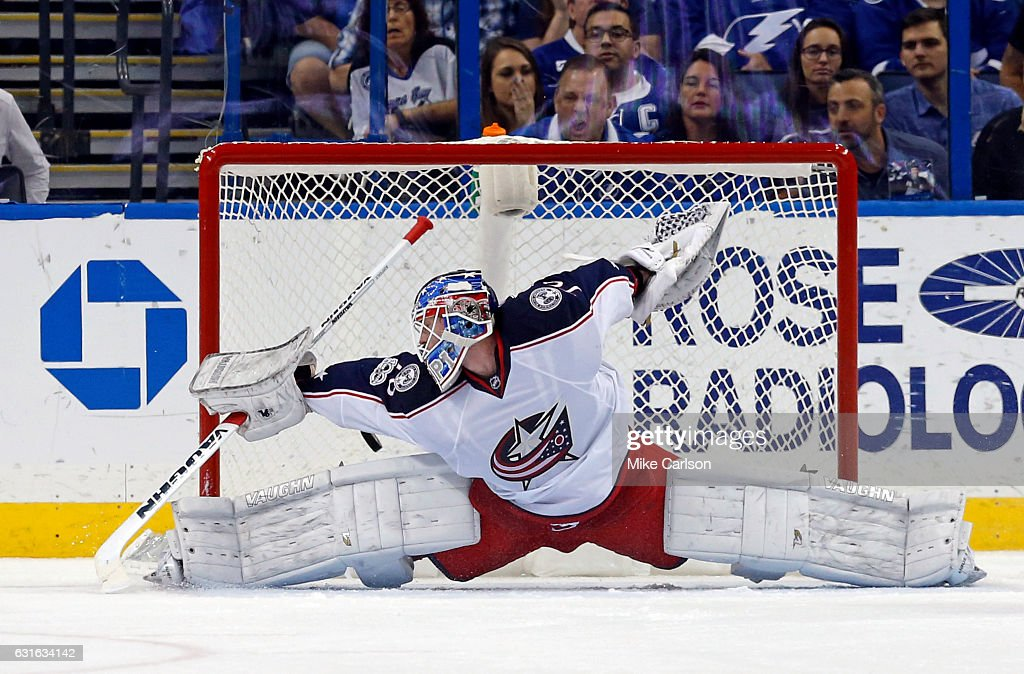 Joonas Korpisalo #70 of the Columbus Blue Jackets allows a goal by the Tampa Bay Lightning at the Amalie Arena on January 13, 2017 in Tampa, Florida.