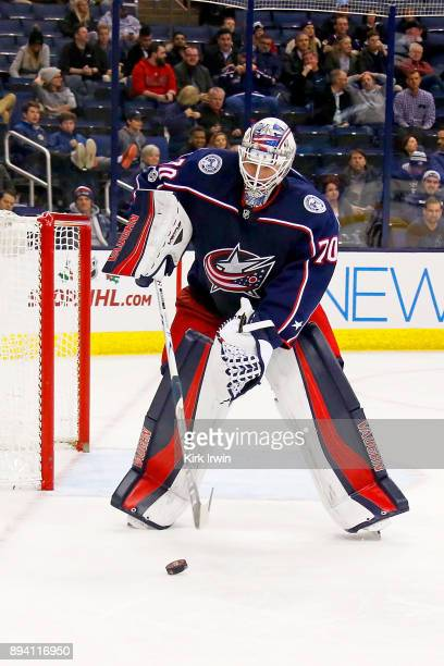 Joonas Korpisalo of the Columbus Blue Jackets controls the puck during the game against the Edmonton Oilers on December 12 2017 at Nationwide Arena...