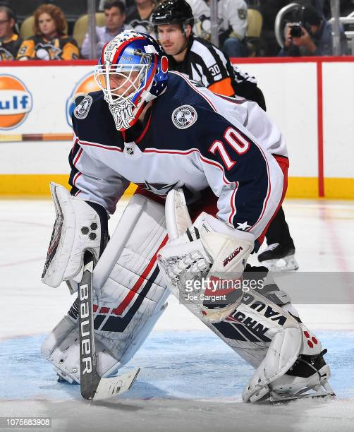 Joonas Korpisalo of the Columbus Blue Jackets defends the net against the Pittsburgh Penguins at PPG Paints Arena on November 24 2018 in Pittsburgh...