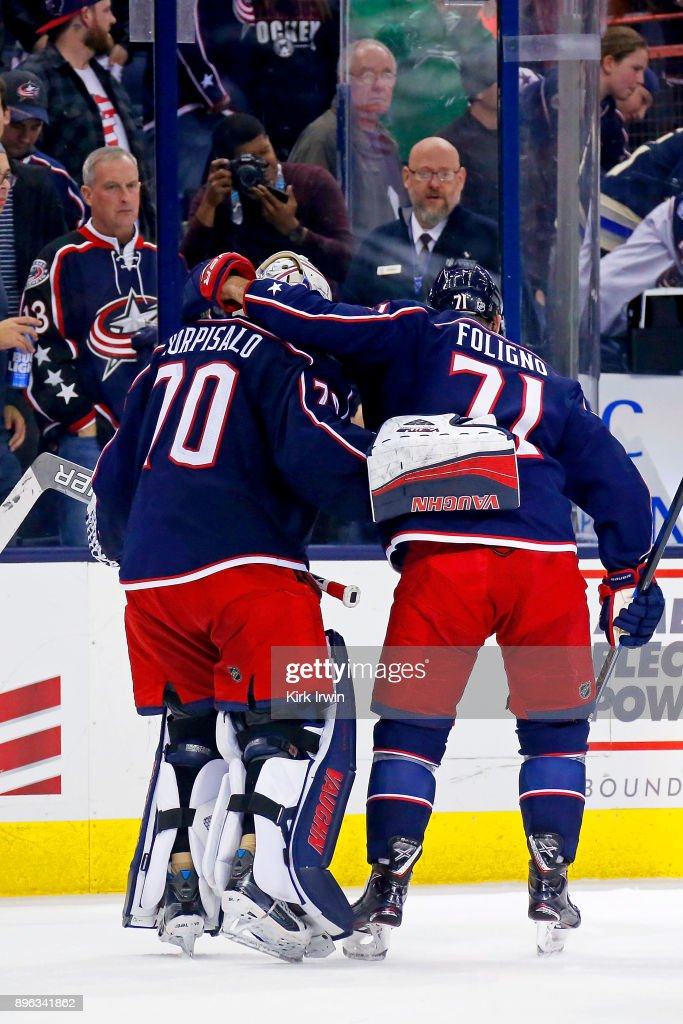 Joonas Korpisalo #70 of the Columbus Blue Jackets is congratulated by Nick Foligno #71 of the Columbus Blue Jackets after defeating the Toronto Maple Leafs 4-2 on December 20, 2017 at Nationwide Arena in Columbus, Ohio.