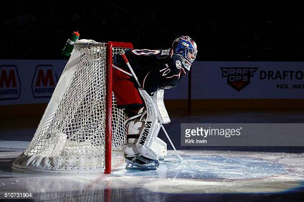 Joonas Korpisalo of the Columbus Blue Jackets is spot lit during player introductions prior to the start of the game against the Boston Bruins on...