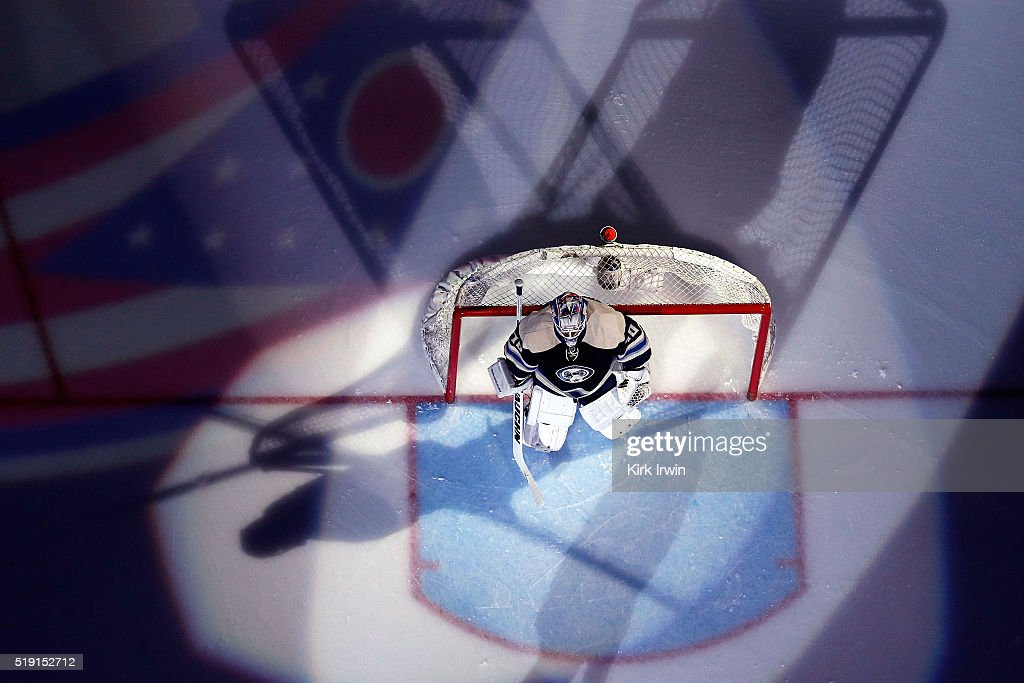 Joonas Korpisalo #70 of the Columbus Blue Jackets is spot lit during player introductions prior to the start of the game against the New York Rangers on April 4, 2016 at Nationwide Arena in Columbus, Ohio. New York defeated Columbus 4-2.