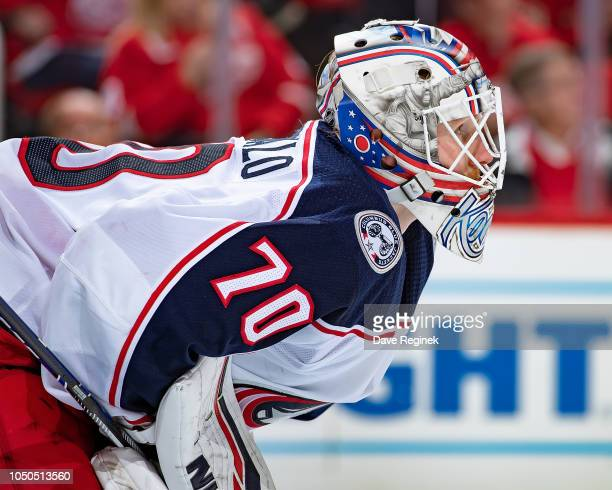 Joonas Korpisalo of the Columbus Blue Jackets looks down the ice against the Detroit Red Wings during an NHL game at Little Caesars Arena on October...