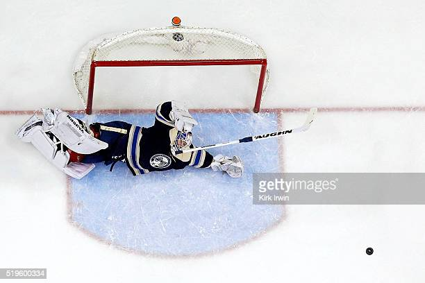 Joonas Korpisalo of the Columbus Blue Jackets looses his stick while diving to make a save during the game against the New York Rangers on April 4...