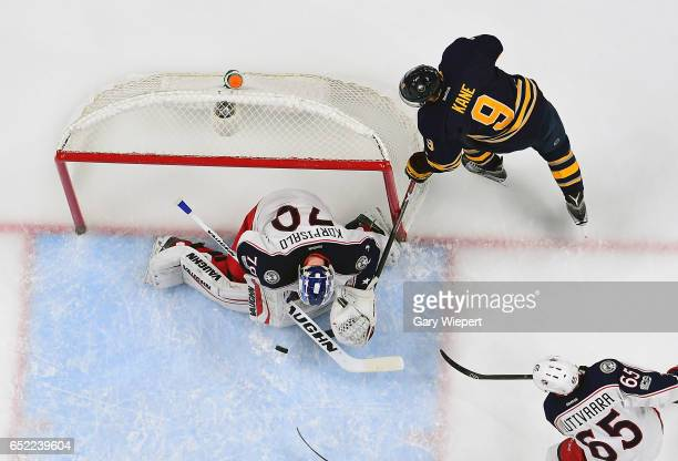 Joonas Korpisalo of the Columbus Blue Jackets makes a first period save against Evander Kane of the Buffalo Sabres during an NHL game at the KeyBank...