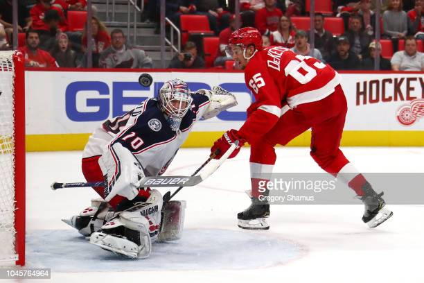 Joonas Korpisalo of the Columbus Blue Jackets makes a overtime save on Danny DeKeyser of the Detroit Red Wings at Little Caesars Arena on October 4...