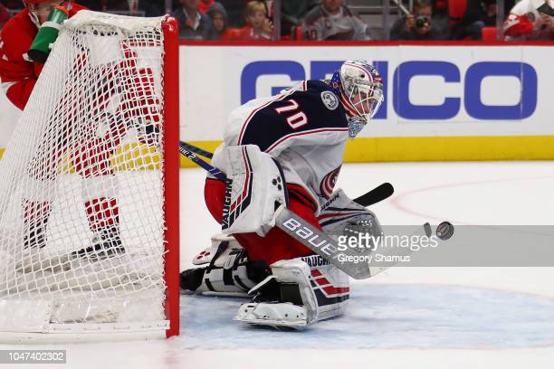 Joonas Korpisalo of the Columbus Blue Jackets makes a save against the Detroit Red Wings at Little Caesars Arena on October 4 2018 in Detroit Michigan