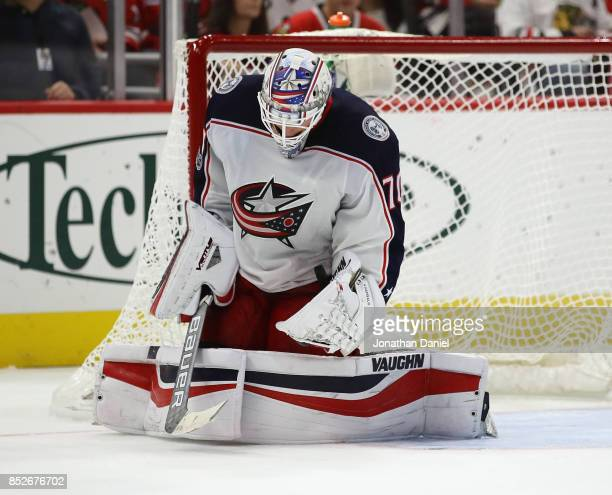 Joonas Korpisalo of the Columbus Blue Jackets makes a save against the Chicago Blackhawks during a preseason game at the United Center on September...