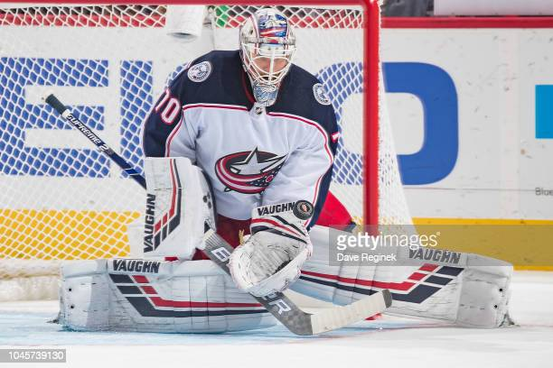 Joonas Korpisalo of the Columbus Blue Jackets makes a save during an NHL game against the Detroit Red Wings at Little Caesars Arena on October 4 2018...