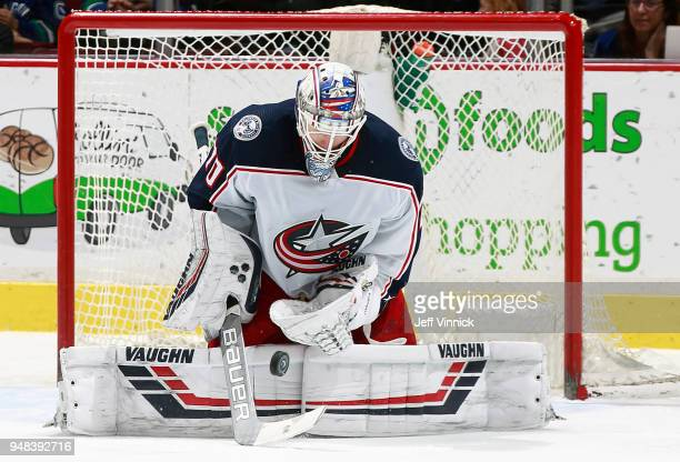 Joonas Korpisalo of the Columbus Blue Jackets makes a save during their NHL game against the Vancouver Canucks at Rogers Arena March 31 2018 in...