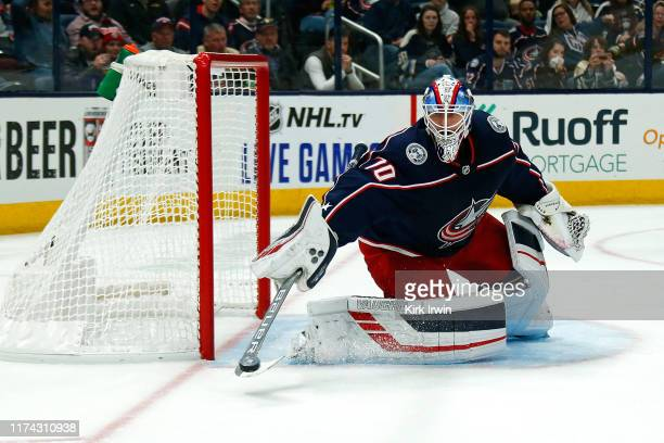 Joonas Korpisalo of the Columbus Blue Jackets makes a save during the first period of the game against the Buffalo Sabres on October 7 2019 at...