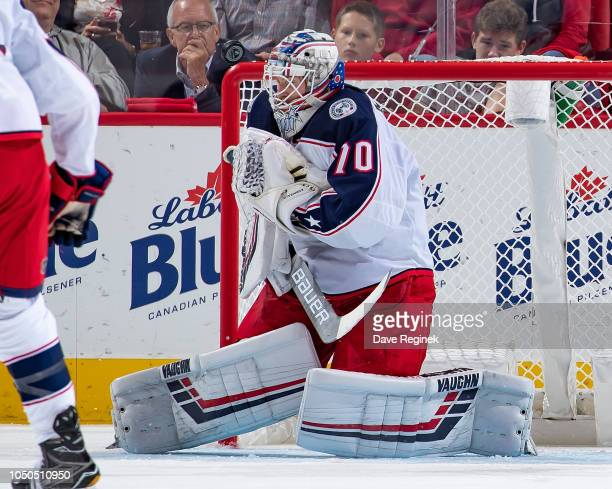 Joonas Korpisalo of the Columbus Blue Jackets makes a shoulder save against the Detroit Red Wings during an NHL game at Little Caesars Arena on...