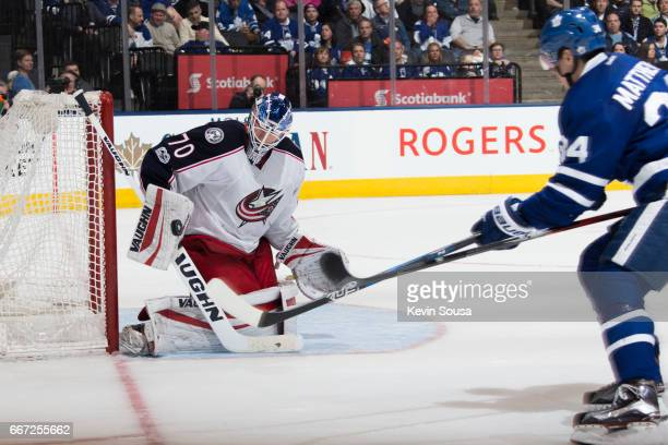 Joonas Korpisalo of the Columbus Blue Jackets makes a stick save against Auston Matthews of the Toronto Maple Leafs during the second period at the...
