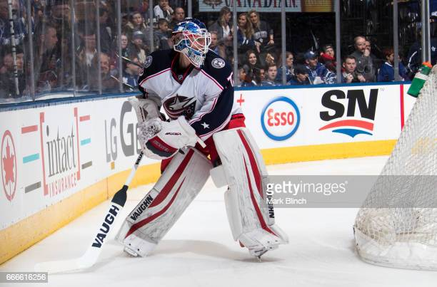 Joonas Korpisalo of the Columbus Blue Jackets plays the puck against the Toronto Maple Leafs during the first period at the Air Canada Centre on...