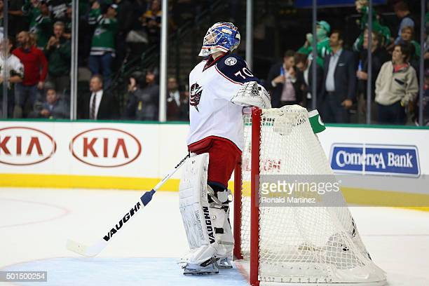 Joonas Korpisalo of the Columbus Blue Jackets reacts after giving up a goal against the Dallas Stars in the first period at American Airlines Center...