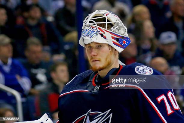 Joonas Korpisalo of the Columbus Blue Jackets skates back to the net during a stoppage in play in the game against the Toronto Maple Leafs on...