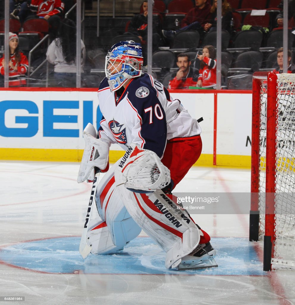 Joonas Korpisalo #70 of the Columbus Blue Jackets skates in warm-ups prior to the game against the New Jersey Devils at the Prudential Center on March 5, 2017 in Newark, New Jersey.
