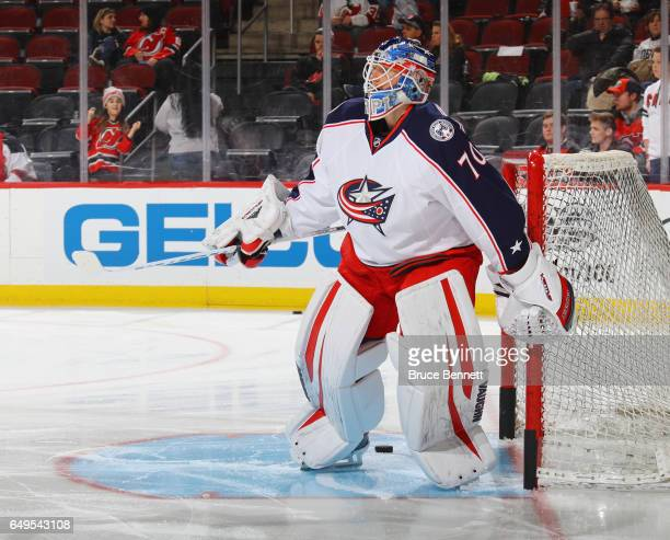 Joonas Korpisalo of the Columbus Blue Jackets skates in warmups prior to the game against the New Jersey Devils at the Prudential Center on March 5...
