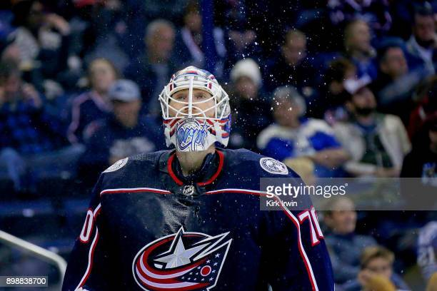 Joonas Korpisalo of the Columbus Blue Jackets spits out water after taking a drink during the game against the Toronto Maple Leafs on December 20...