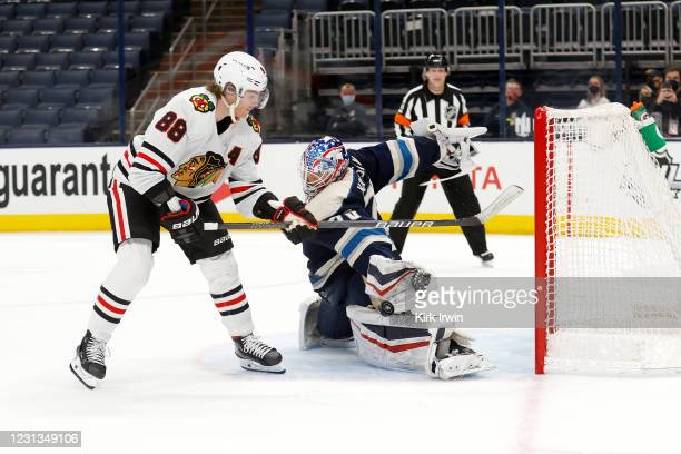 Joonas Korpisalo of the Columbus Blue Jackets stops a shot by Patrick Kane of the Chicago Blackhawks during the shootout at Nationwide Arena on...