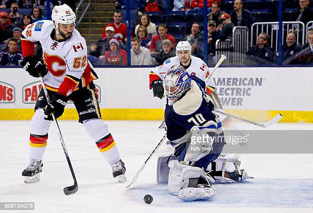 Joonas Korpisalo of the Columbus Blue Jackets stops a shot from Brandon Bollig of the Calgary Flames during the third period on January 21 2016 at...
