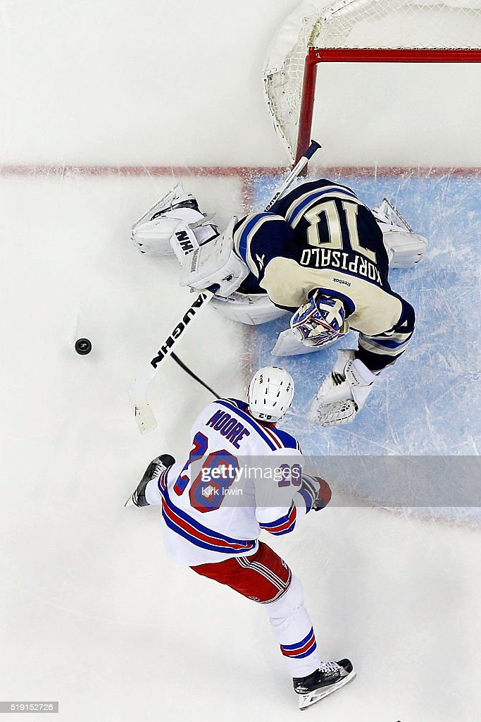 Joonas Korpisalo #70 of the Columbus Blue Jackets stops a shot from Dominic Moore #28 of the New York Rangers during the first period on April 4, 2016 at Nationwide Arena in Columbus, Ohio. New York defeated Columbus 4-2.