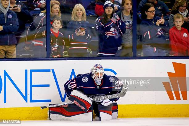 Joonas Korpisalo of the Columbus Blue Jackets stretches while fans watch pregame warmups prior to the start of the game against the Edmonton Oilers...