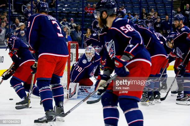 Joonas Korpisalo of the Columbus Blue Jackets warms up prior to the start of the game against the Montreal Canadiens on March 12 2018 at Nationwide...