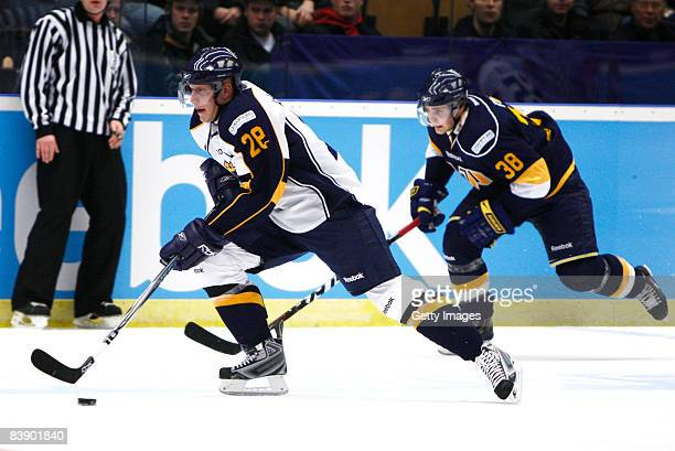 Joonas Naettinen and Nichlas Torp of Espoo Blues fights for the puck during the IIHF Champions Hockey League match between HV 71 Joenkoeping and...