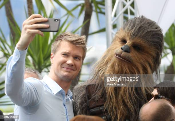 "Joonas Suotamo and Chewbacca attend the photocall for ""Solo: A Star Wars Story"" during the 71st annual Cannes Film Festival at Palais des Festivals..."