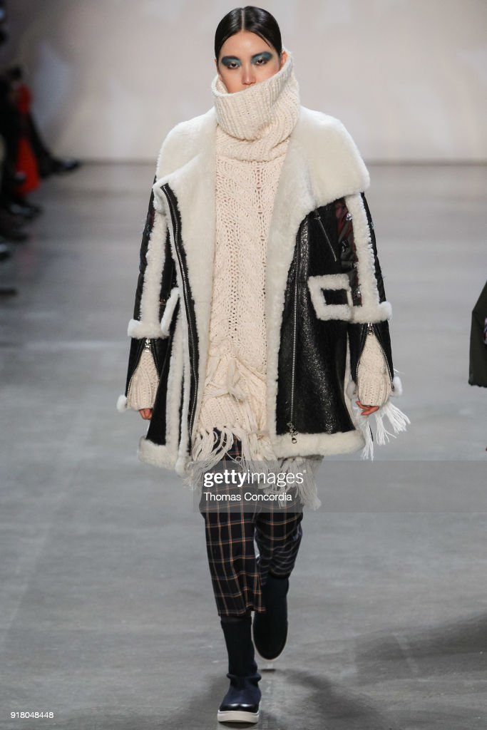 Joony Kim walks the runway wearing Vivienne Tam Fall 2018 with makeup by Fawn Monique and Hair by Moroccanoil at Gallery I at Spring Studios on February 13, 2018 in New York City.