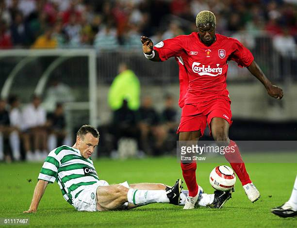 Joos Valgaeren of Celtic tries to steal the ball from Djibril Cisse of Liverpool July 26 2004 at Rentschler Field in East Hartford Connecticut